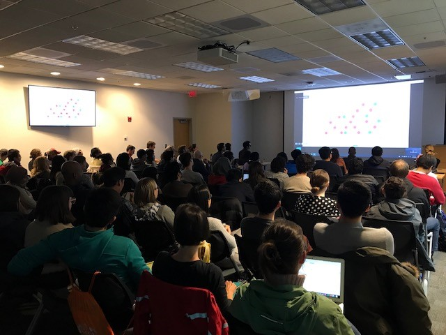 A standing-room-only audience listens during the Coronavirus Forum Monday in the Parker Petit Institute for Bioengineering and Biosciences. (Photo by Renay San Miguel.)