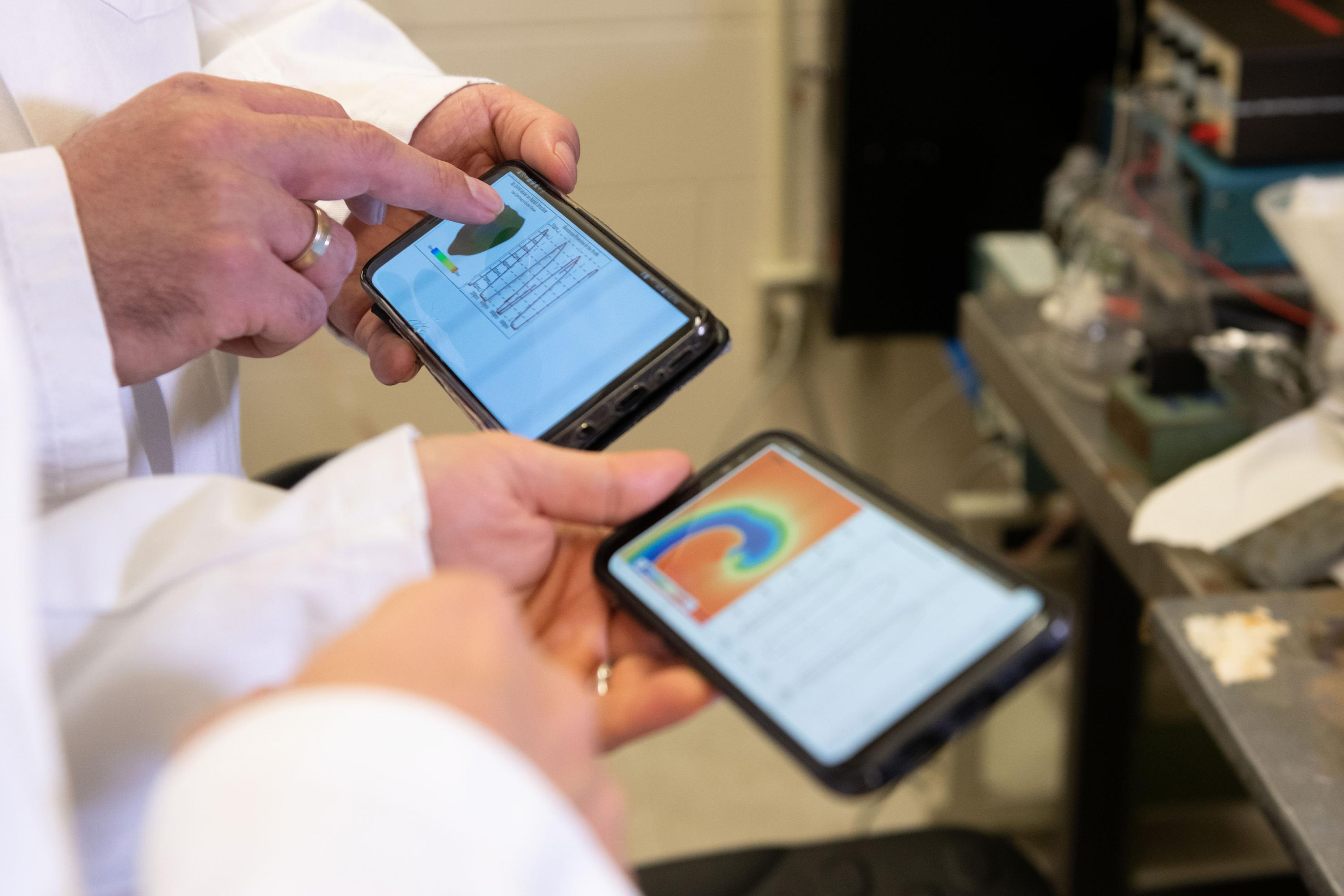 Smartphone screens showing cardiac simulations