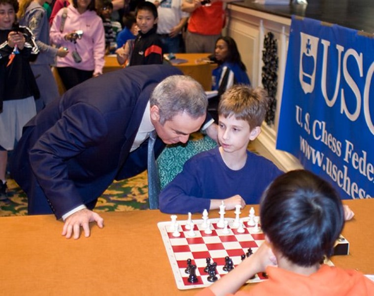 Chess grandmaster Garry Kasparov and 11-year-old Daniel Gurevich.