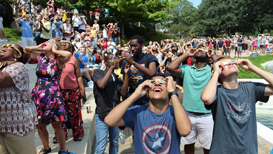 Georgia Tech students observing the almost total solar eclipse around the campanile