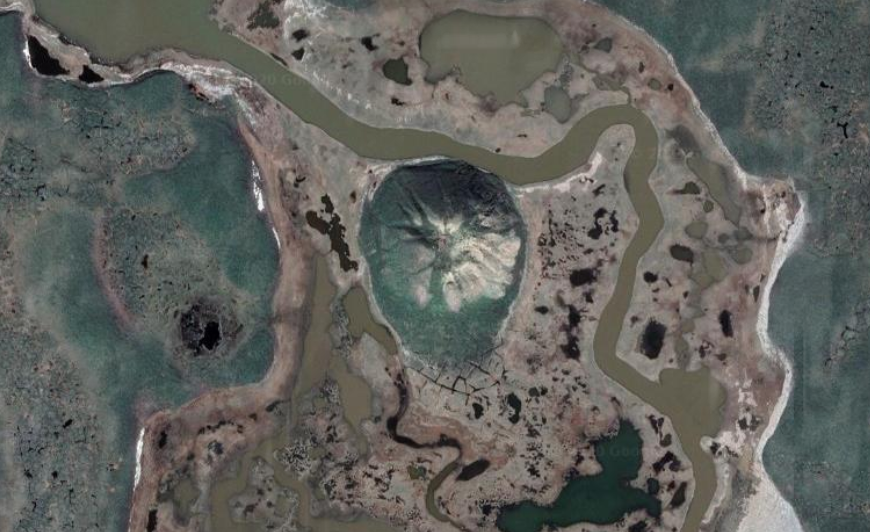 Ibyuk Pingo in Canada, as seen from directly above. Mars, Ceres, and the Earth have abundant reserves of ground ice. On Earth, ice-cored mounds known as pingos are important indicators of groundwater systems and local climate. Credit: Google Earth