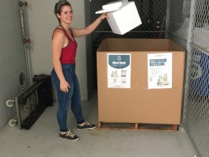 Graduate student Hannah Viola using the Gaylord collection box in Krone EBB