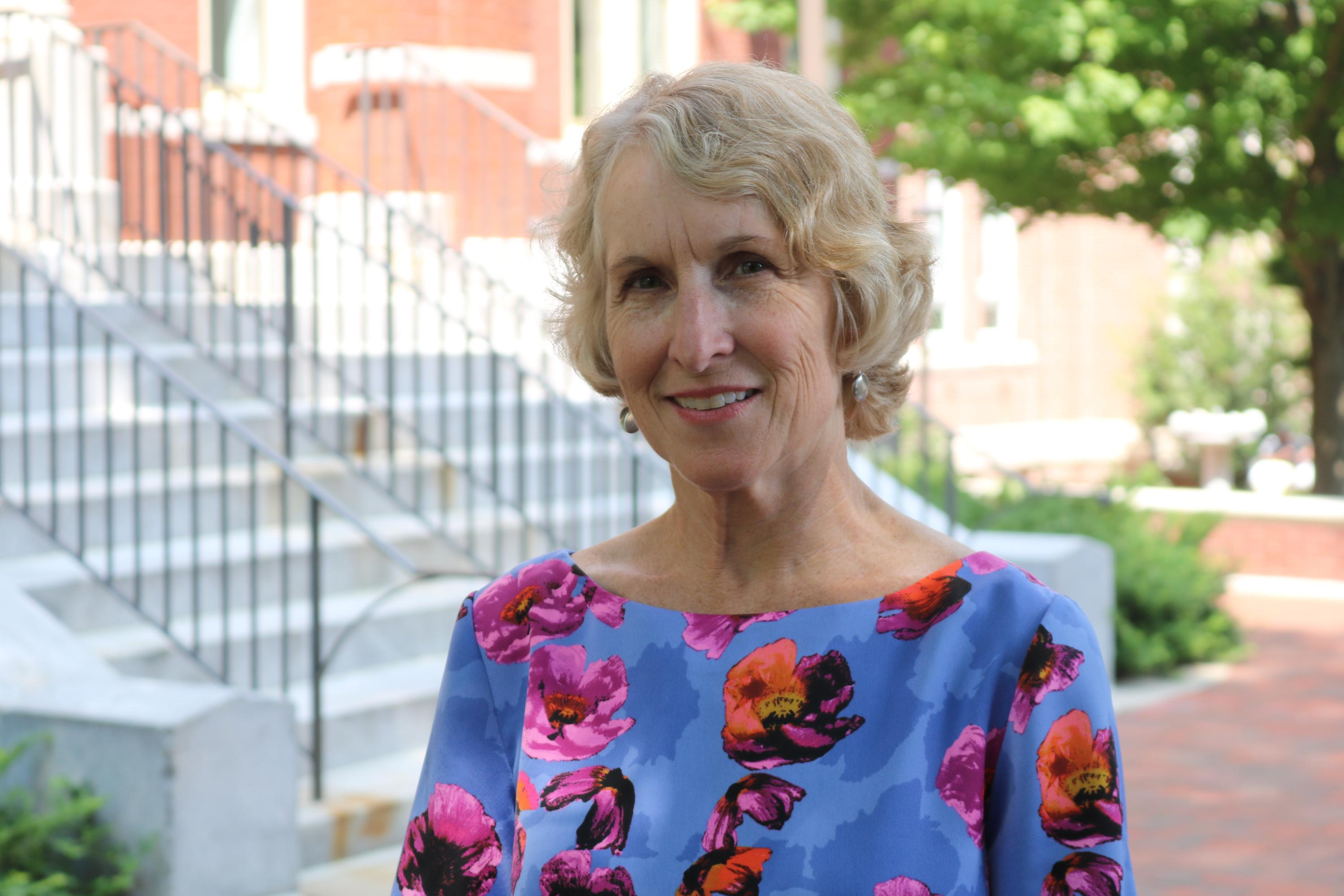 Susan Lozier in front of Tech Tower